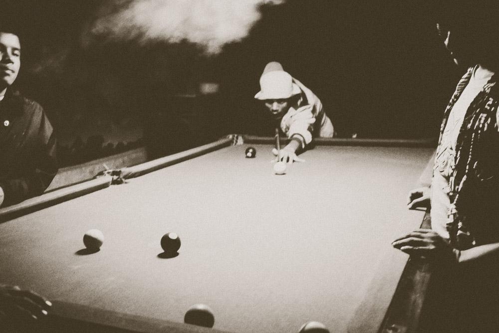 Playing pool and smoking marijuana