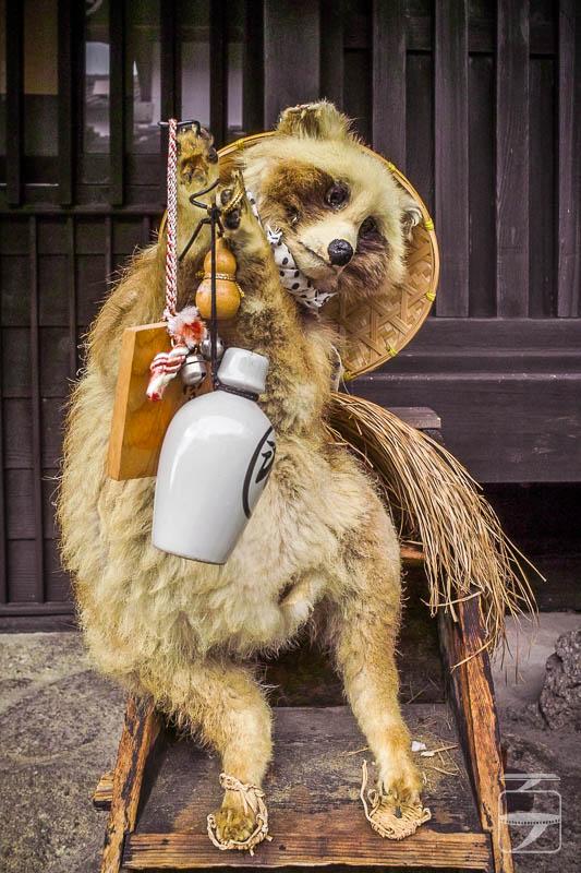 Fox with sake bottle
