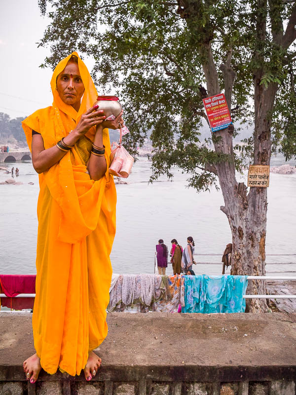 Woman in orange posing during the Hare Krishna festival in Orcha