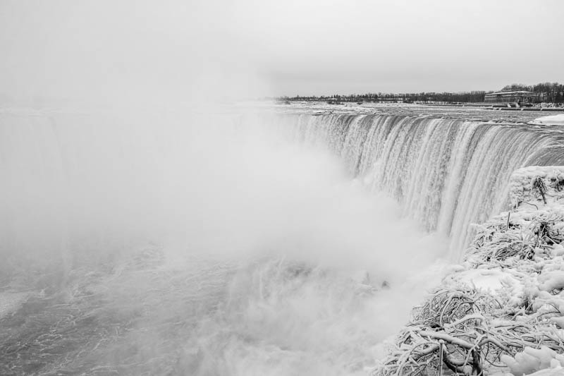 Due to the mist and droplets of water everything is frozen around the falls