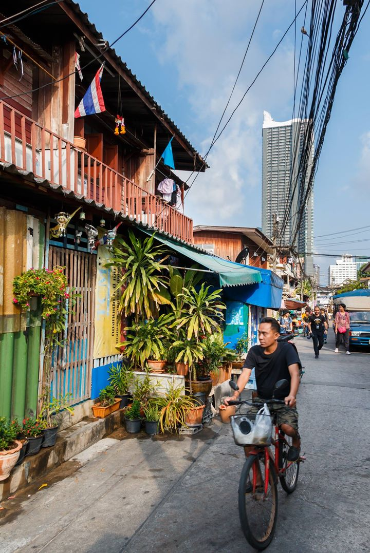 The contrast between the tall luxury condominiums and the small houses is what makes Bangkok so interesting